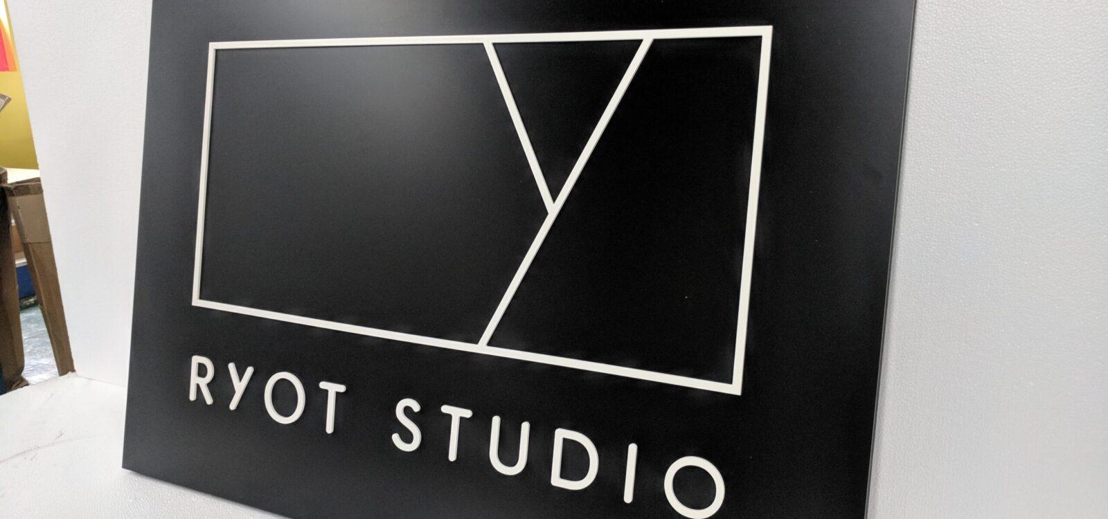 Foamex Faced Ryot Studio Logo Mounted Onto Painted Black Polystyrene