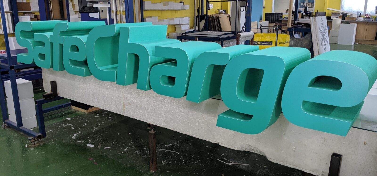 Polystyrene Safecharge Logo For An Exhibition