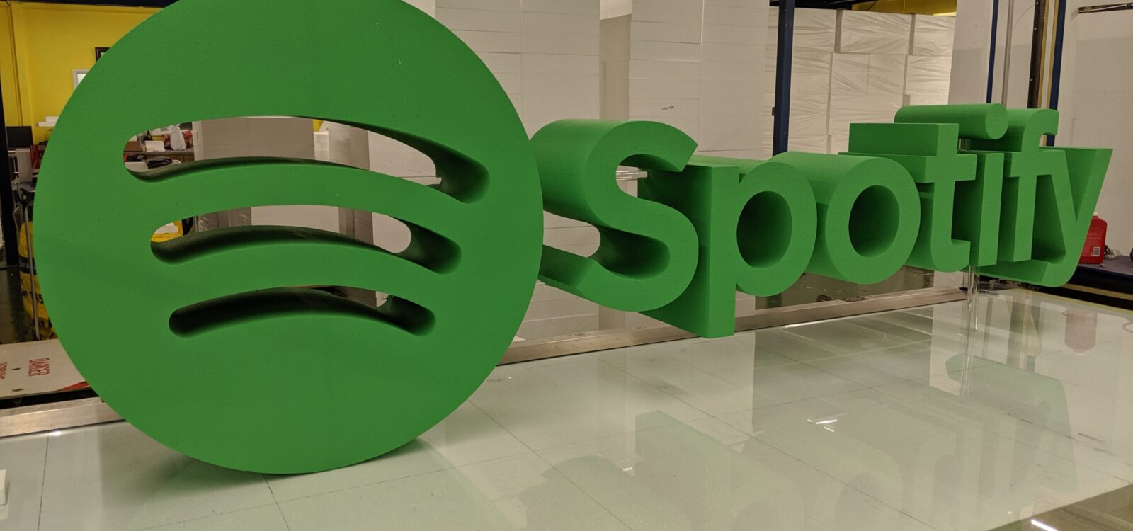 Painted Polystyrene Spotify Logo Held Together With Clear Acrylic Poles
